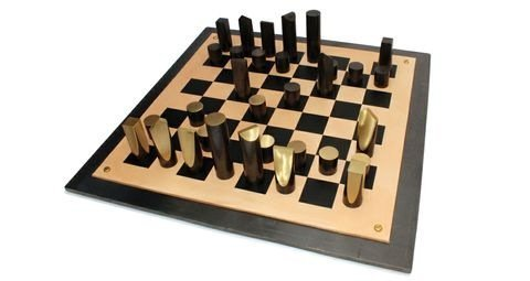 <p><strong>Simon Hasan</strong>, Slice Chess Set, 2012</p><p>Patinated brass, screen printed leather, hot rolled steel plate, brass fittings</p><p>60 W x 60 D x 2 H cms</p><p>Edition of 3 plus 1 Artist's Proof</p>