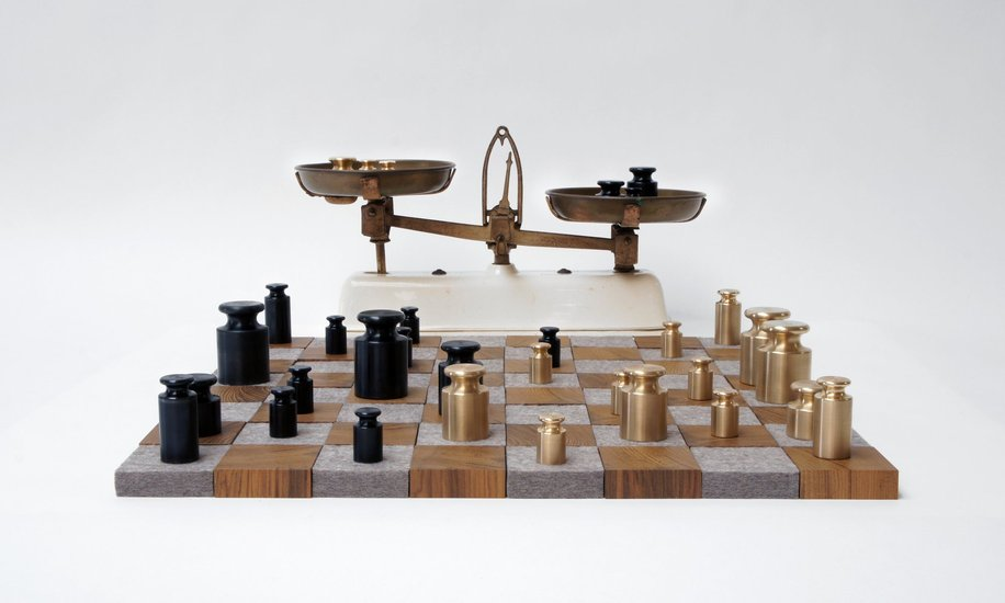 <p><strong>Rolf Sachs</strong>, Weighing up the Competition chess set, 2012</p><p>Brass, enamel, teak, felt, vintage scales</p><p>Board: 56 W x 56 D x 2.2 H cms</p><p>Edition of 1 plus 1 Artist's Proof</p>